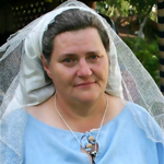 Maria Kalderash's early period veil makes her look as if she is preparing for first holy communion.