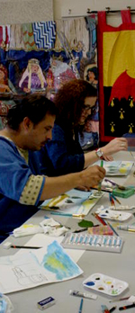 Seleone scribes and illuminators paint scrolls for the Twelfth Night Christmas Feast.